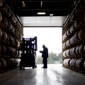 Whiskey barrels in storage