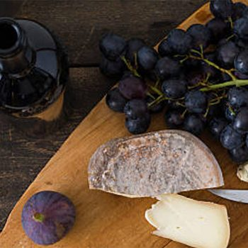 table with grapes and cheese